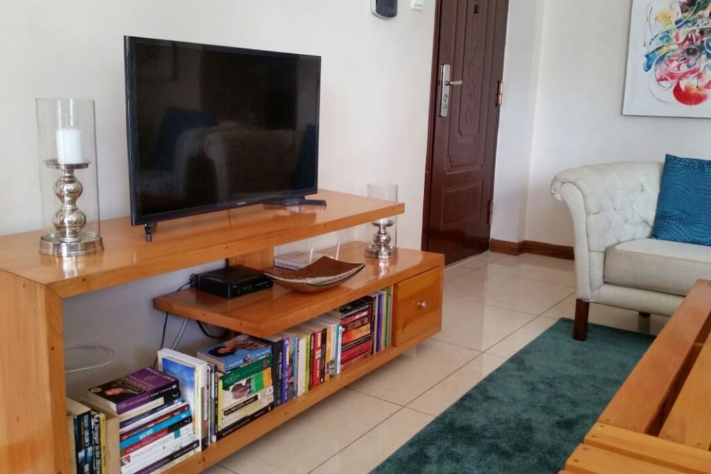 The TV stand which doubles up as the the book case holding our small library with books from different genres ranging from Biographies, self-help books, fiction and of course some law journals!