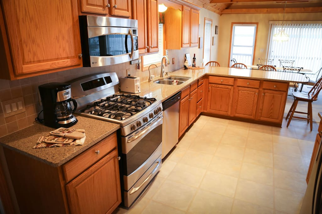 The large kitchen with a breakfast bar into the dining room.