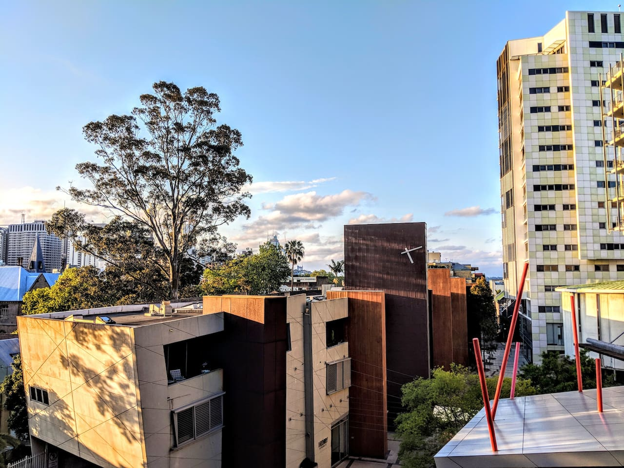 View from balcony of city skyline and glimpses of the Harbour Bridge