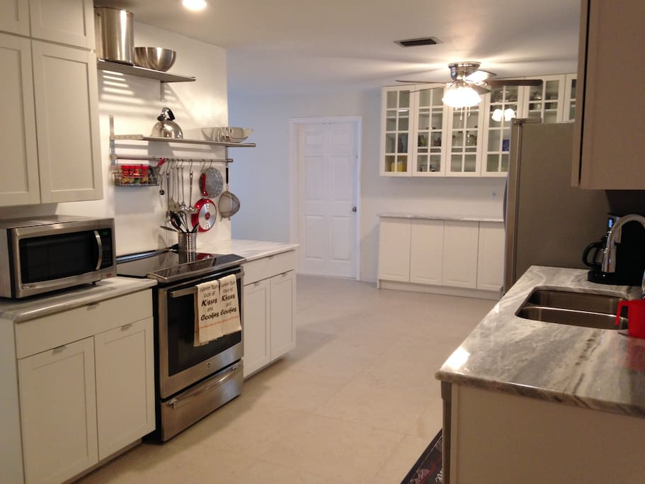 Huge chef kitchen recently updated with marble counters and stainless steel appliances