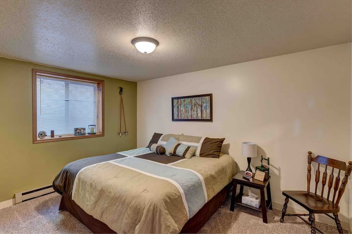 King size bed with smart TV in bedroom.