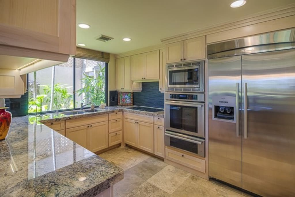 """German engineered Thermador built-in kitchen with 48"""" fridge, gourmet oven, triple insulated dishwasher, easy to clean ceramic cooktop, Bosch washer/dryer, Deep Sinks, Granite counters, cool kitchen tools, beautiful china and glassware."""