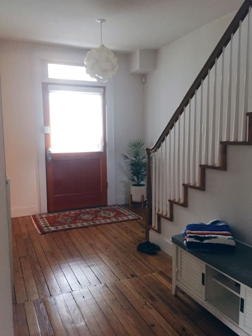 Entryway filled with high ceilings, natural light and 100+ year old hardwood floors.