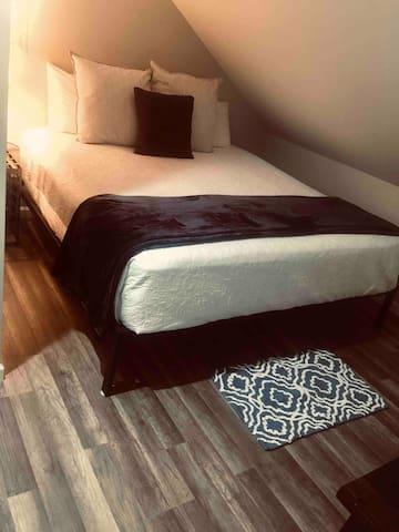 #4 Bedroom. King bed next to bathroom.