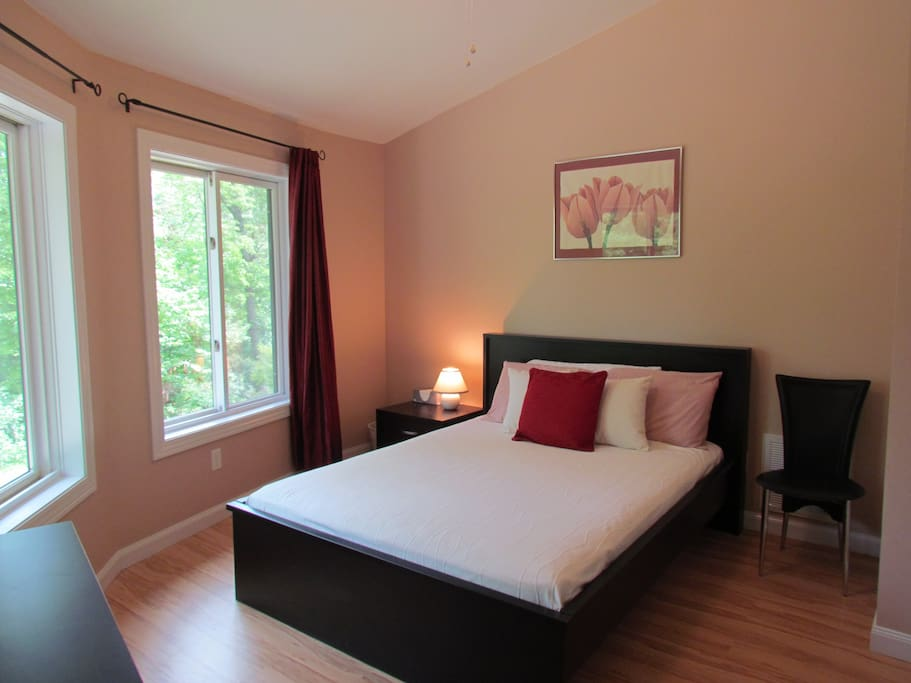 """The queen bed in this private and serene bedroom has been described as """"very comfy."""""""