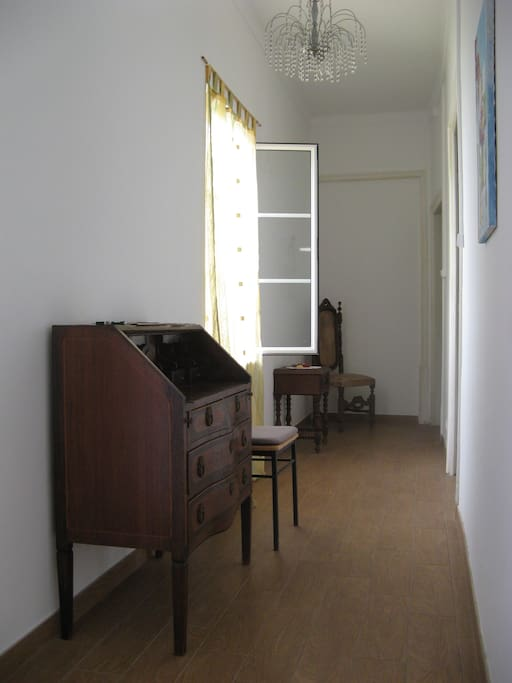 Hallway with window to quintal