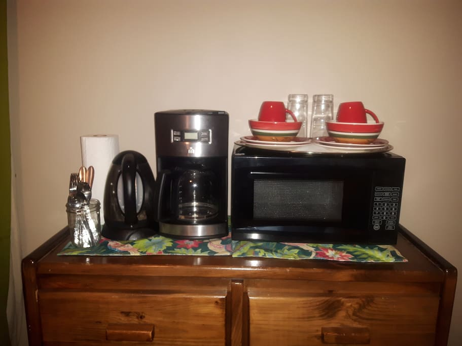 Enjoy basic kitchenette amenities: kettle, coffee maker, microwave, dishes & cutlery.