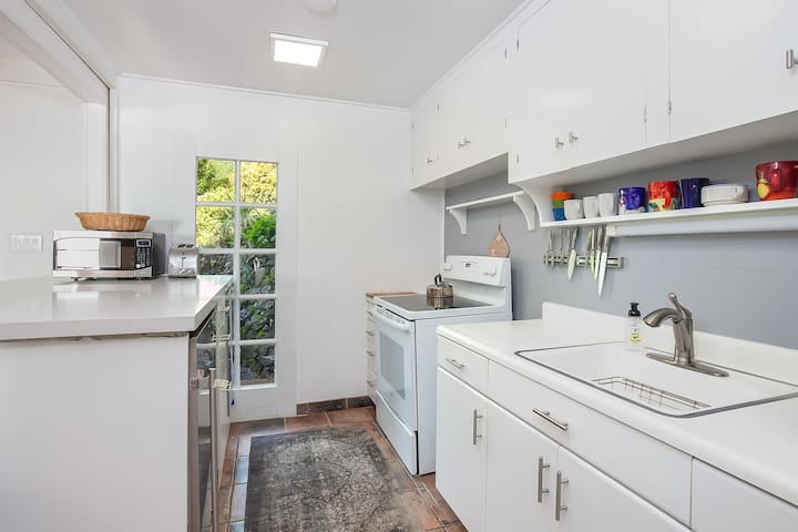 Kitchen is equipped with professional quality fridge and freezer (under bar), electric range, microwave, vitamix, several coffee makers, toaster and the rest.