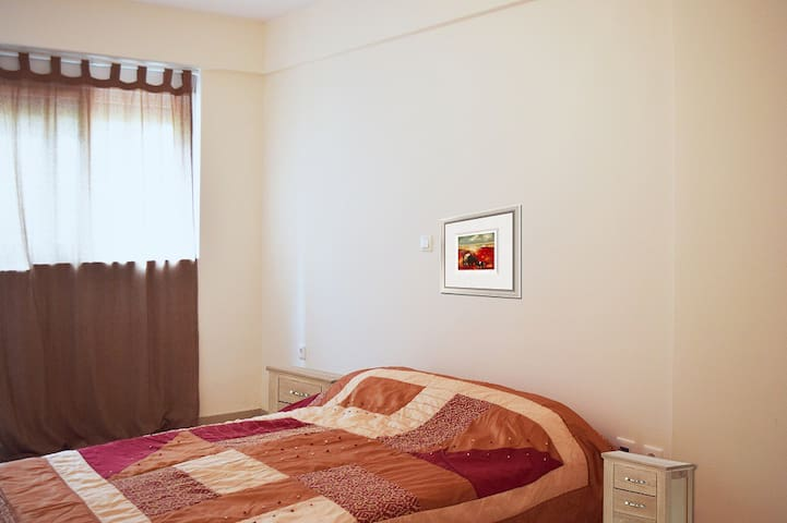 Level -1: A very bright and sunny bedroom with a double bed.