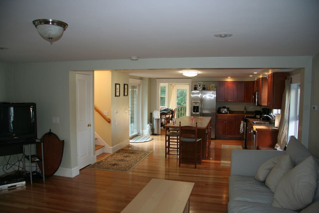 Large, well lit kitchen with sliding door to patio