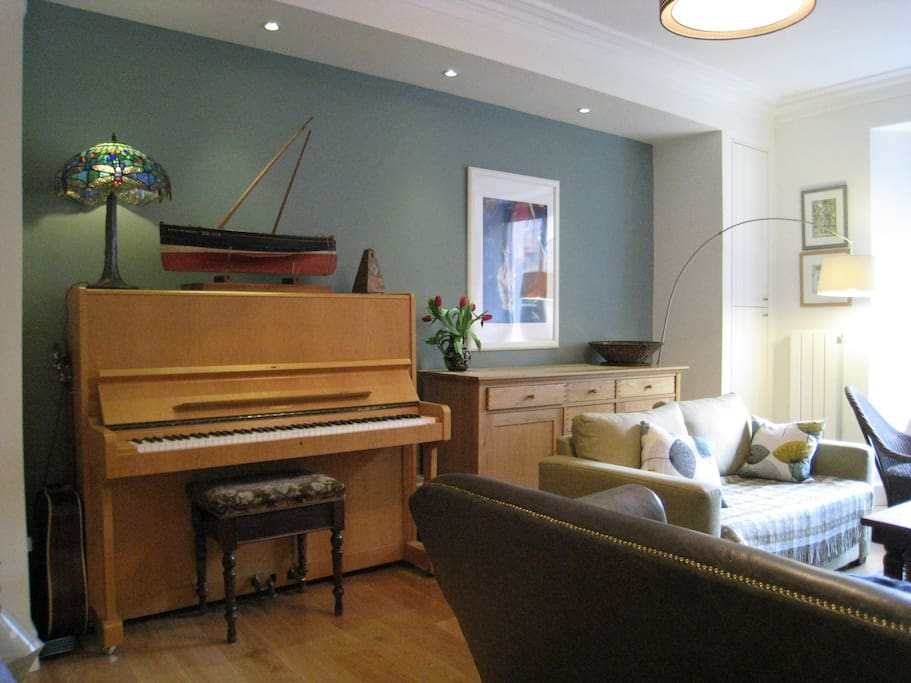 Living room with upright piano
