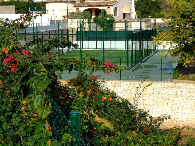Landscaped gardens and Padel tennis court