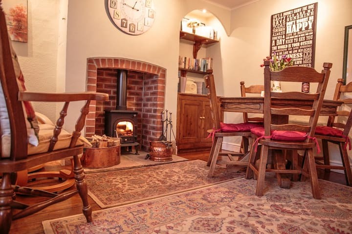 Traditional dining room with wood burning stove