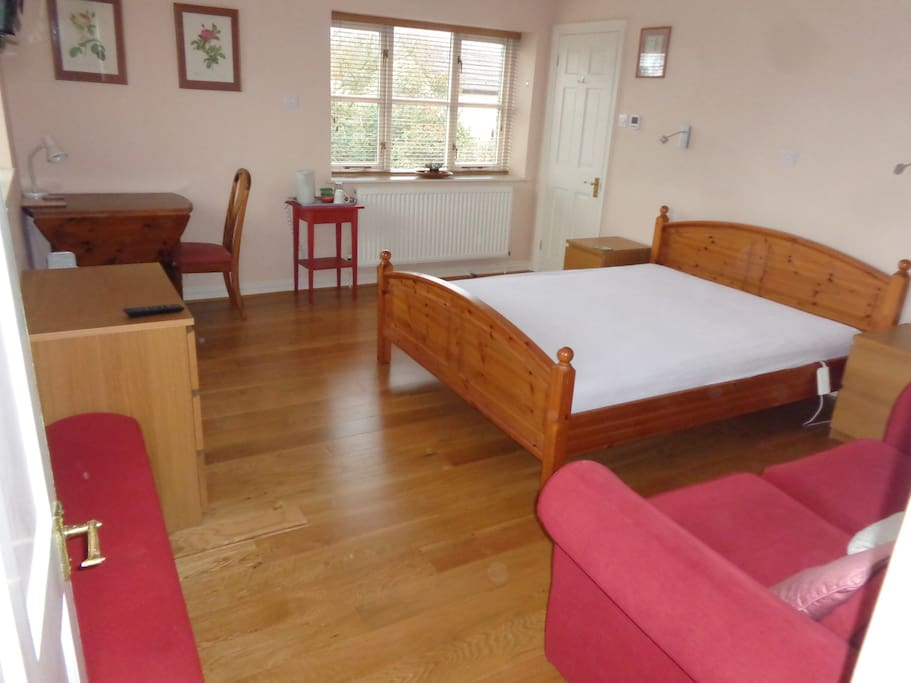 Sofa, King Size bed, table and chair, tea making facilities.