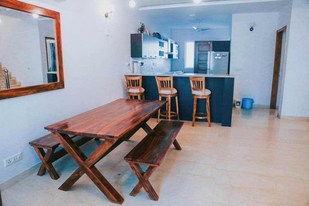 Our dining bench for the family meal and a view of our open-concept kitchen.