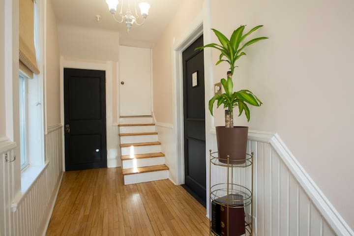 Front entryway (upper flat door to the right, lower flat door straight ahead, both with keypad entry).
