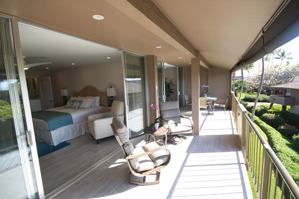 Huge floor to ceiling glass doors open up the Master bedroom and Living room to your lanai.