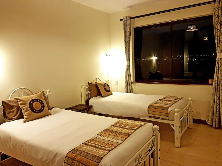 Comfortable, clean accommodation in the private bedroom. Enjoy the lovely views of the city and neighborhood.