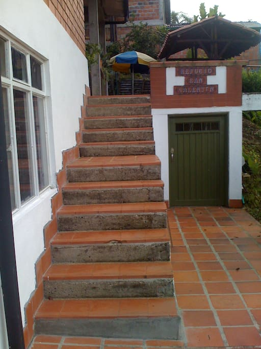 Access to the second floor (bedrooms, bathrooms, kitchen, comun areas, BBQ and kiosk