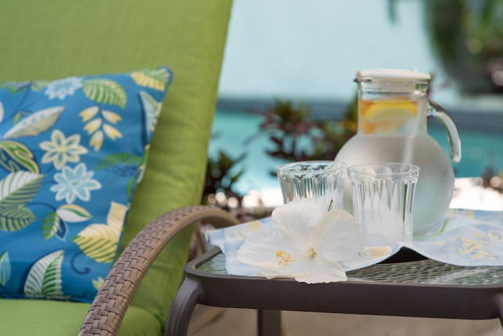 Relax with refreshments by the pool.