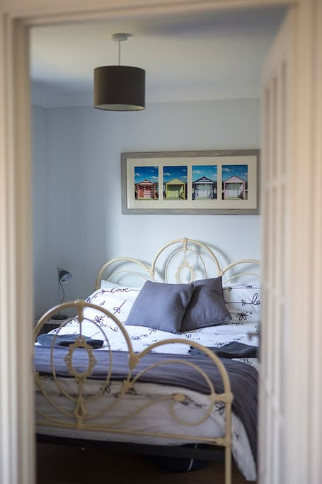 Tastefully decorated main bedroom with local photos.