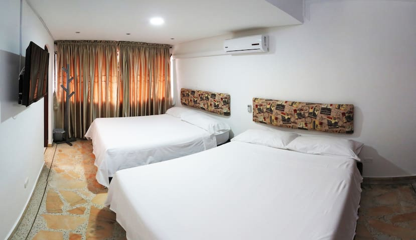 ROOM WITH TWO QUEEN SIZE BEDS AND A/C