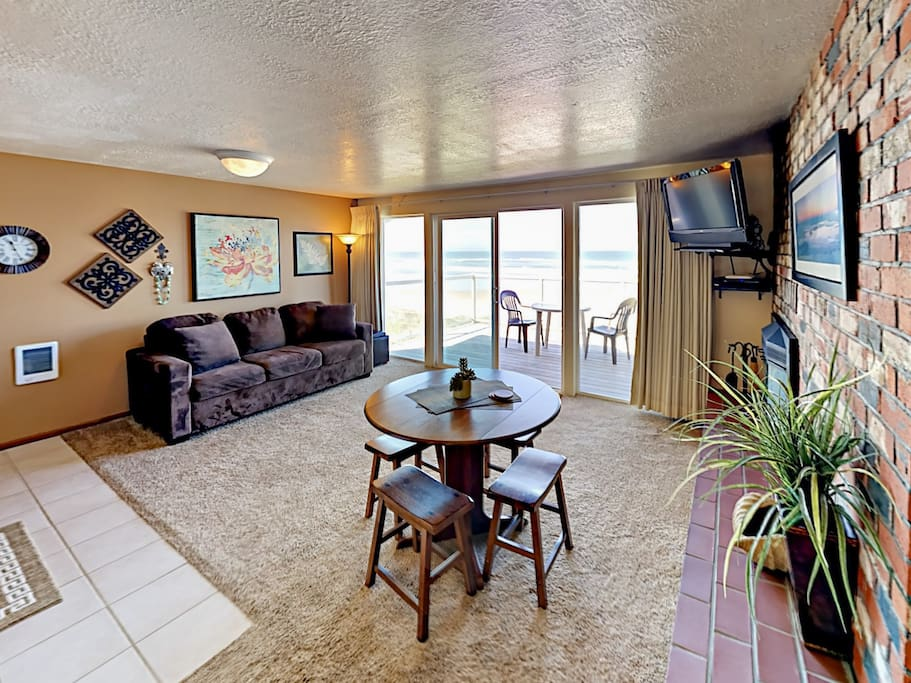 The sunlit living space provides stunning views of the ocean.