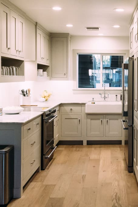 European Custom cabinets with Carrara Marble counter tops