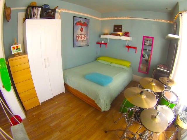 Double Bed, some storage and Drum kit