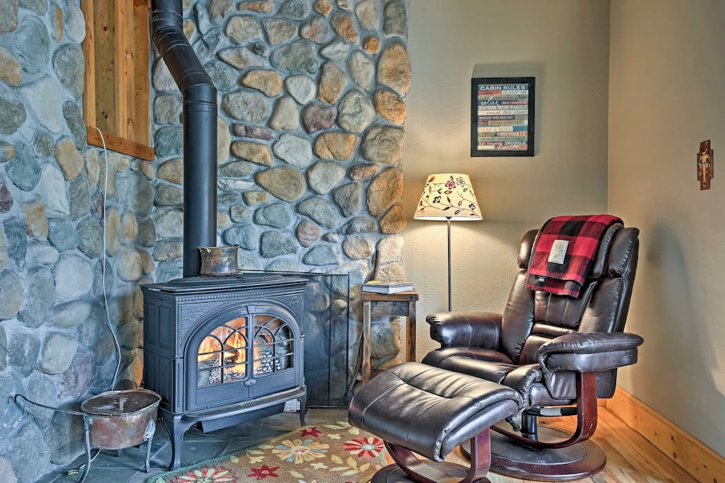The 1,300-sq-ft interior is filled with lovely decor like this river rock wall.
