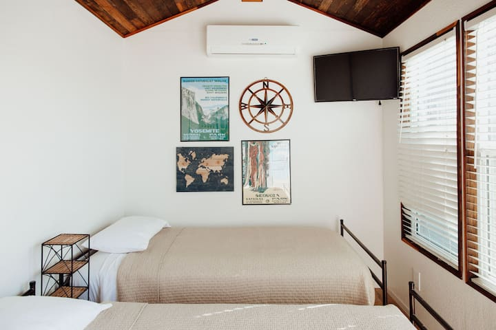 The Redwood room with two twin beds and private bathroom.