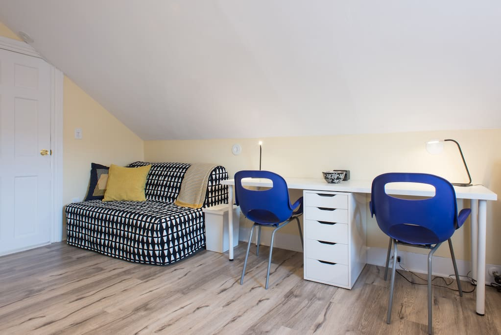 Studio includes two full sofa beds, two desk spaces, an adjustable drawing table, lots of places to put supplies and very large shelving for paper storage.  A bureau for clothing and a television as well.