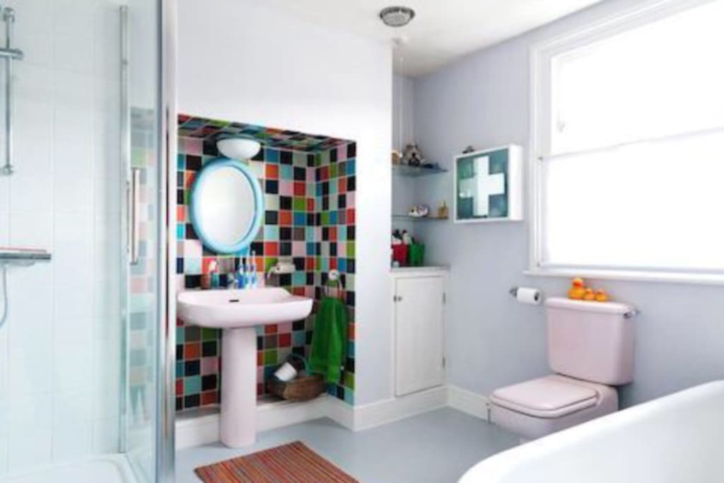 This is our very large shared bathroom, there is a shower and bath available for you to use.