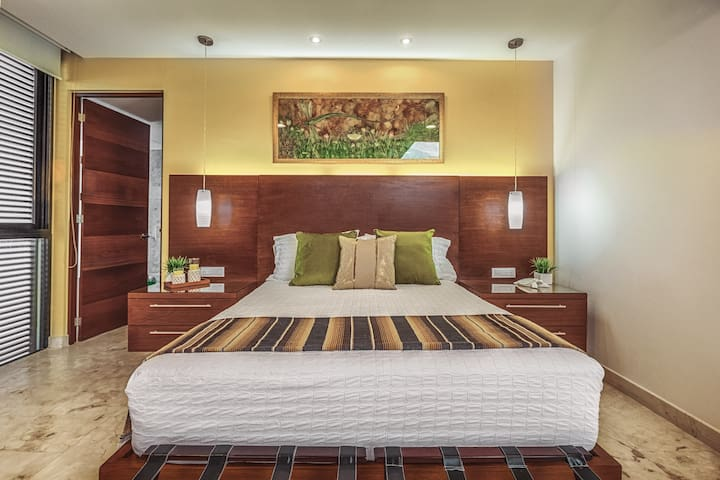 A spacious master bedroom awaits you.