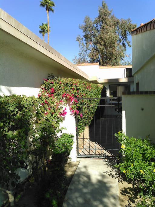 Front walkway with beautiful bougainvilleas.