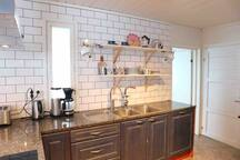 Open kitchen and Finnish design dishes  like Iittala. You find everything you need for cooking and baking in this kitchen.