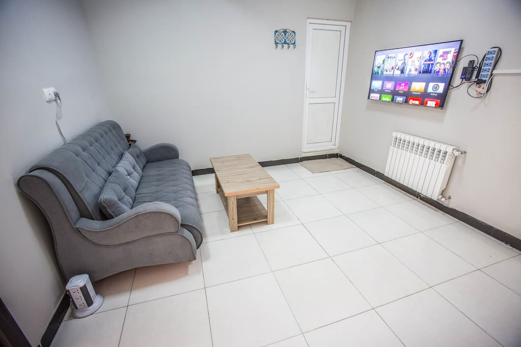 Entertainment room with Apple TV (feel free to sign into your Netflix or iTunes accounts if you have one)