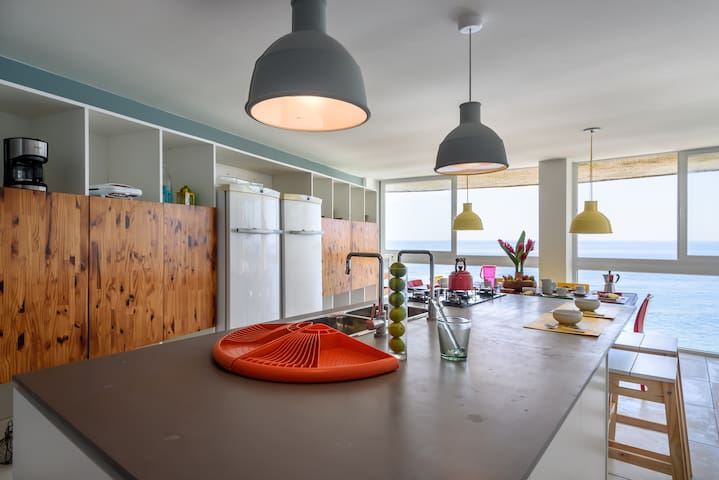 The kitchen is a wonderful place to hang out, cook, drink and look out over the ocean.