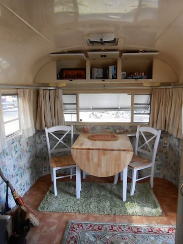 Small dining/game table for spending quiet time when there is too much activity in the Community House.  Fix your breakfast or supper in the Community House and dine in the peace and quiet of your private vintage trailer.