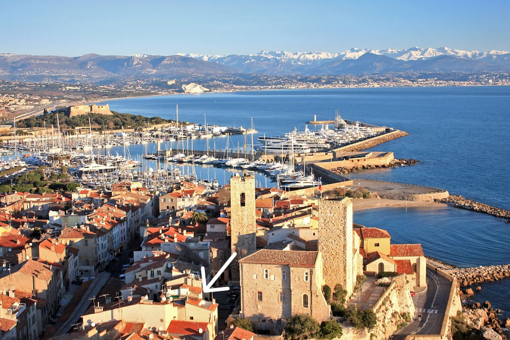 The old town of Antibes with a view over the marina bay