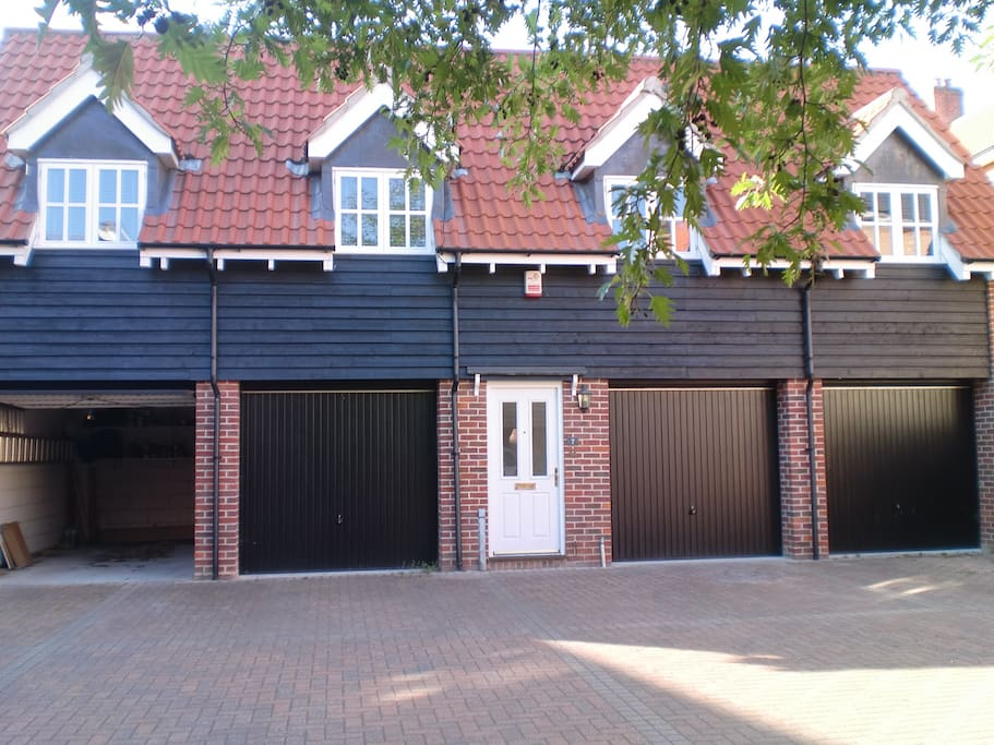 Front door with car parking outside garage, right hand side to the front door. Less than 5 minute walk to city centre.
