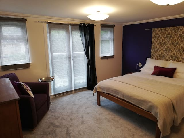 Bedroom 1.  French doors and Glass Balcony