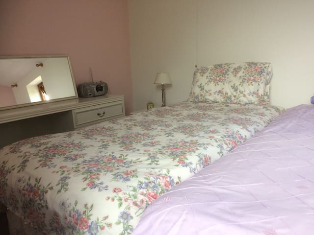 Convert to 2 single beds