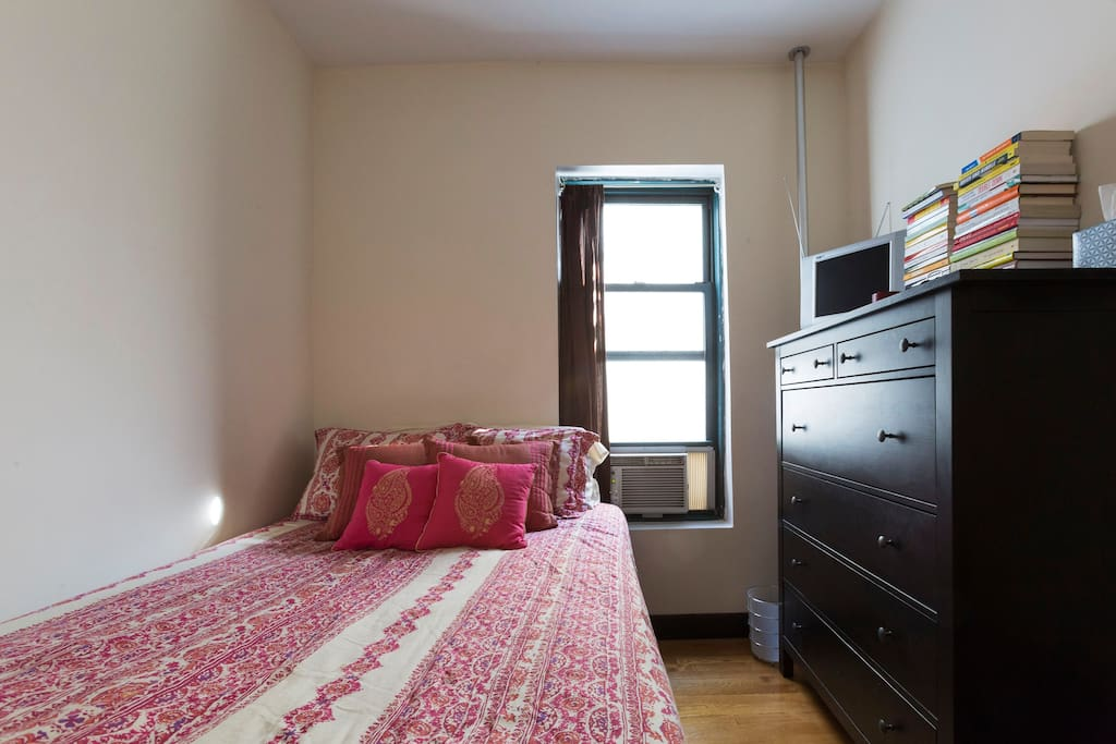 Private room with full size bed with a/c unit in room