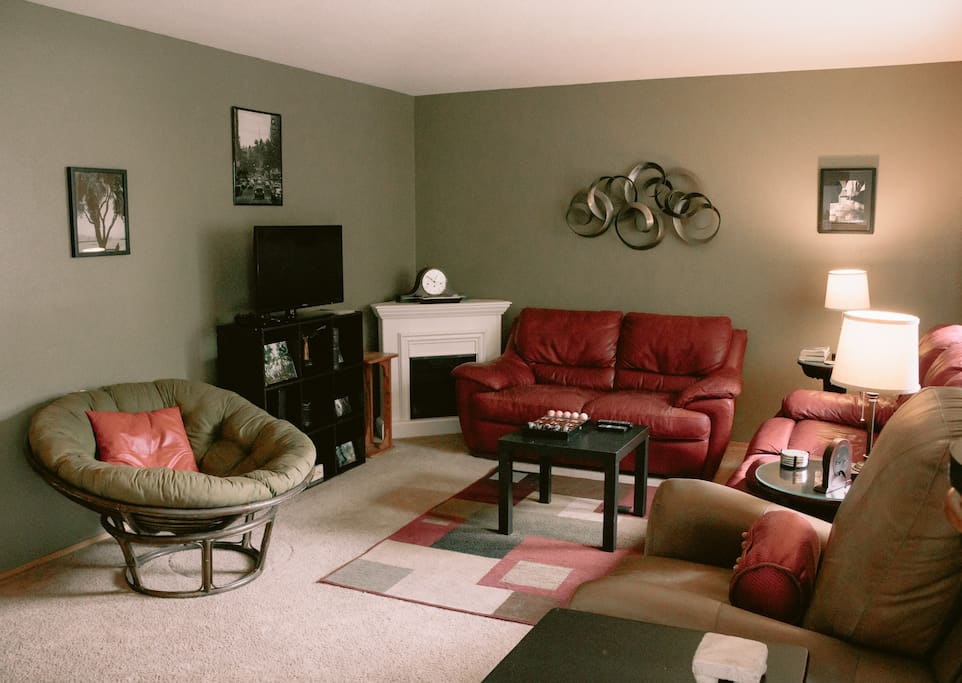 Living room includes: reclining leather sofas, extra seating, electric heating, TV and Xbox 360