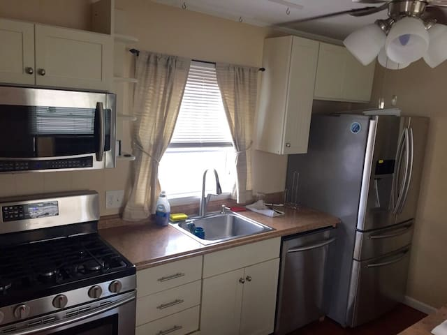 kitchen has high-end Samsung appliances, including a gas stove.  'Frig has wine cooler