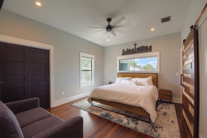 "California King Tempur-pedic bed and a full-size sleeper sofa in the bedroom.  Also a 65"" TV"