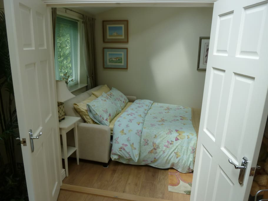 Entrance to guest bedroom from dining kitchen.