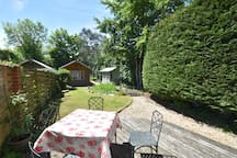 Outside dining area with front garden view