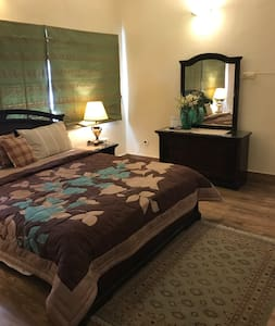 Furnished room with attached bath at Seaview, DHA
